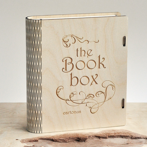 Wooden book box with sliding bolt latch. Laser cut vector model. Project plan for laser cutting. Wooden book box on the table