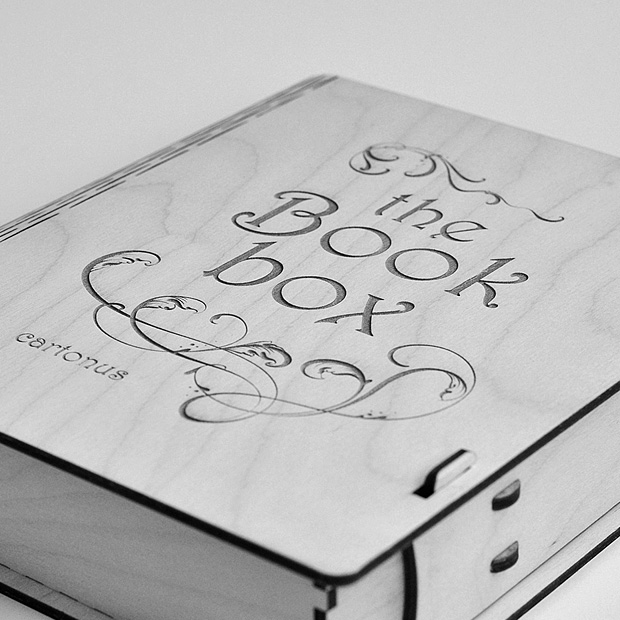 Wooden book box with sliding bolt latch. Laser cut vector model. Project plan for laser cutting. Black and white macro photo of box